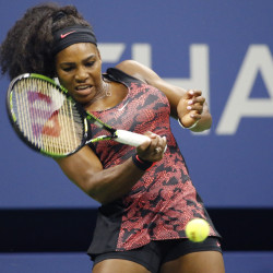 U.S. Open defending champion Serena Williamsreturns a ball during her first round match against Vitalia Diatchenko on Monday in New York. Williams won 6-2, 2-0 after Diatchenko pulled out of the match with an injury.