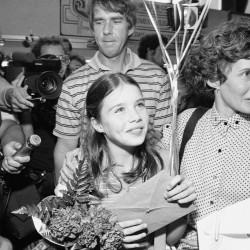 Smith, her father Arthur, background, and mother Jane, receive flowers and gifts as they arrive at the Augusta State Airport on July 22, 1983. The 11-year-old traveled with her parents to Russia for a visit at the invitation of Soviet President Yuri V. Andropov.