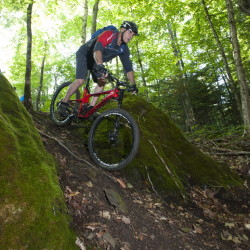 """Tom Chasse of Presque Isle bikes in the area known as Gravity Rock at the Nordic Heritage Center, which hopes to become a biking """"destination"""" despite Presque Isle's remote location."""