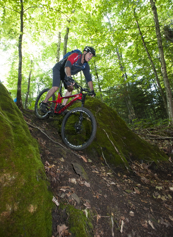 "Tom Chasse of Presque Isle bikes in the area known as Gravity Rock at the Nordic Heritage Center, which hopes to become a biking ""destination"" despite Presque Isle's remote location."