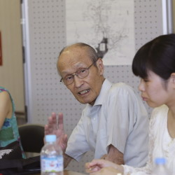 Shigeyuki Katsura, 84, center, a survivor of the Nagasaki atomic bombing, speaks with people who wish to learn and tell his story. He says he feels driven to recount his experience for as long as he lives.
