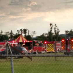 Officers surround the scene of a tent collapse in Lancaster, N.H., on Monday evening. Authorities say the circus tent collapsed when a severe storm hit the fairground.