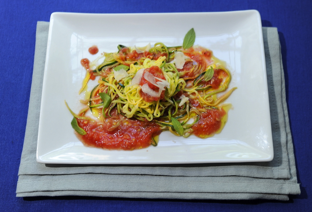 Zucchini noodles with raw tomato sauce offers satisfying heat-free dining.