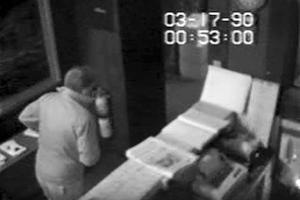 In this March 18, 1990, still image from surveillance video released by the U.S. Attorney's Office,Thursday, Aug. 6, 2015, an unauthorized visitor walks inside the rear entrance of the Isabella Stewart Gardner Museum in Boston. Robbers stole more than a dozen works of art at the museum about 24 hours later. Twenty five years later, the artwork remains missing and no one has ever been charged in the heist. (Isabella Stewart Gardner Museum/U.S. Attorney's Office via AP)
