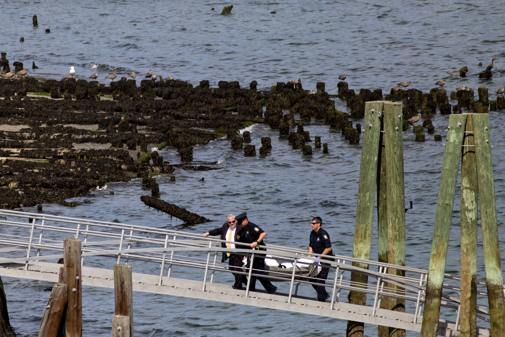 Portland police remove a body from Casco Bay on Monday.