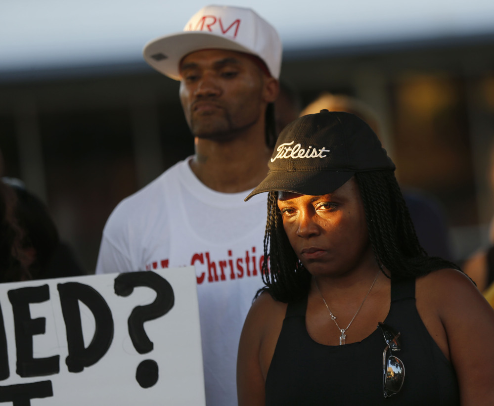 Denise Hamilton of Plano, Texas, attends a vigil for Christian Taylor on Monday in Arlington, Texas. Taylor was killed by police at a car dealership on Friday.