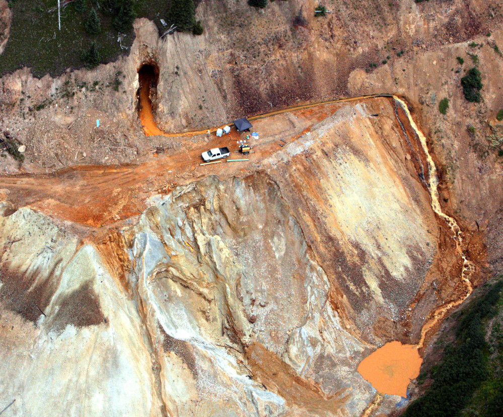 A yellow mix of water and heavy metals continues to stream out of the Gold King Mine near Silverton, Colo., threatening rivers critical to several states and Navajo Nation.