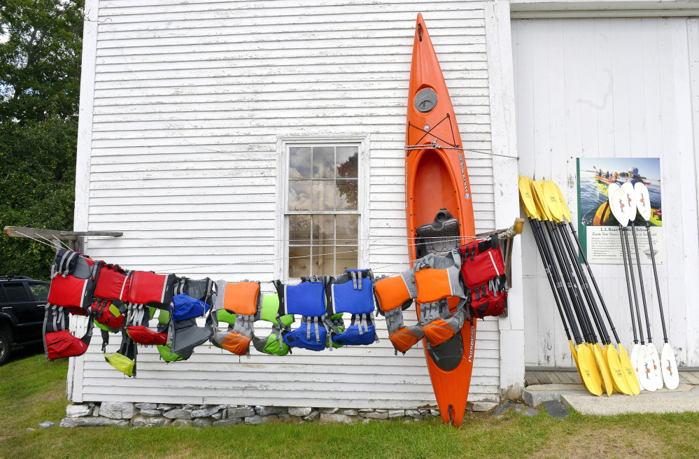 Participants in L.L. Bean's Kayaking Discovery Course start with life jackets, paddles and kayaks, learn basic paddling techniques, and are taught water safety skills.