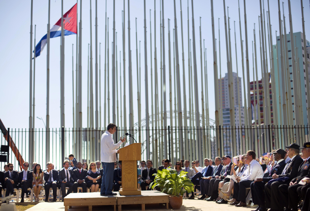 Cuban-American poet Richard Blanco reads his poem Friday during the reopening ceremony of the U.S. embassy in Havana. Blanco, who lives in Bethel, Maine, said he hopes his poem will spur Cubans to reunite emotionally after years of separation.