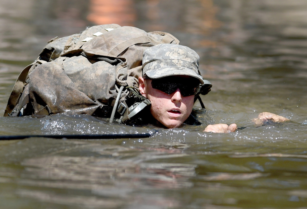 A female Army Ranger candidate crosses the Yellow River on a rope bridge on Aug. 4 at Camp James E. Rudder on Eglin Air Force Base, Fla. Two out of 19 females who started Ranger School this year have completed the course.
