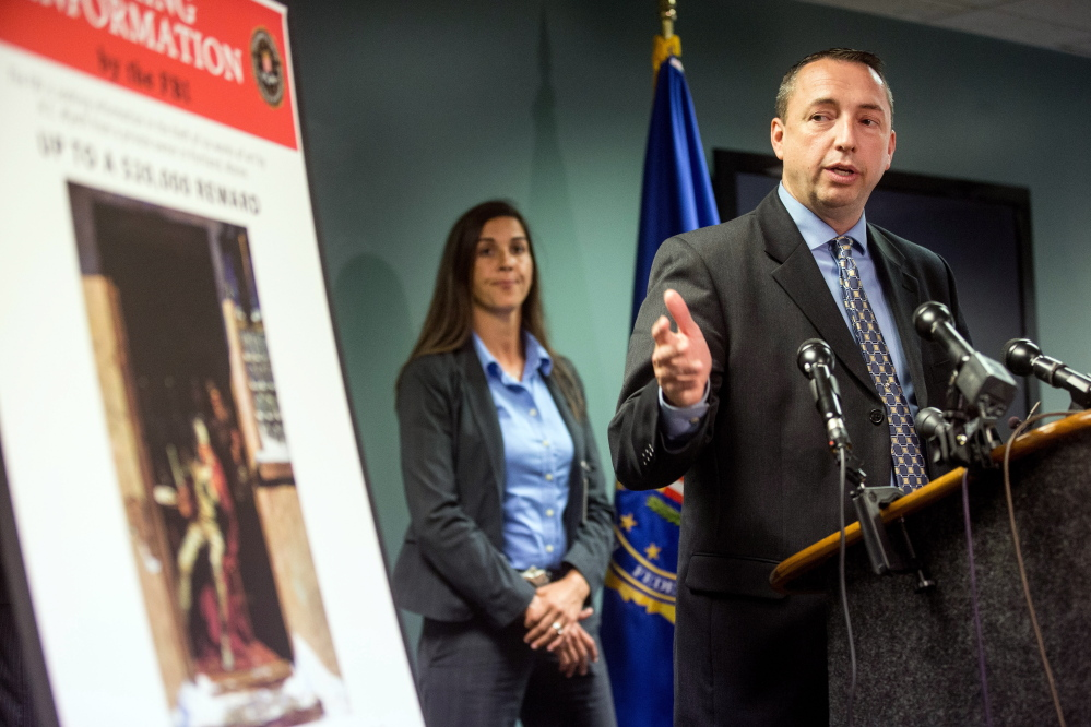 Portland Police Chief Michael Sauschuck said during a news conference at FBI headquarters in Boston on Tuesday that the six N.C. Wyeth paintings stolen in Portland in 2013 were taken from an unoccupied apartment at 18 Monument Square. Two are still missing. At left is Detective Kelly Gorham, who is Portland's lead investigator on the case.