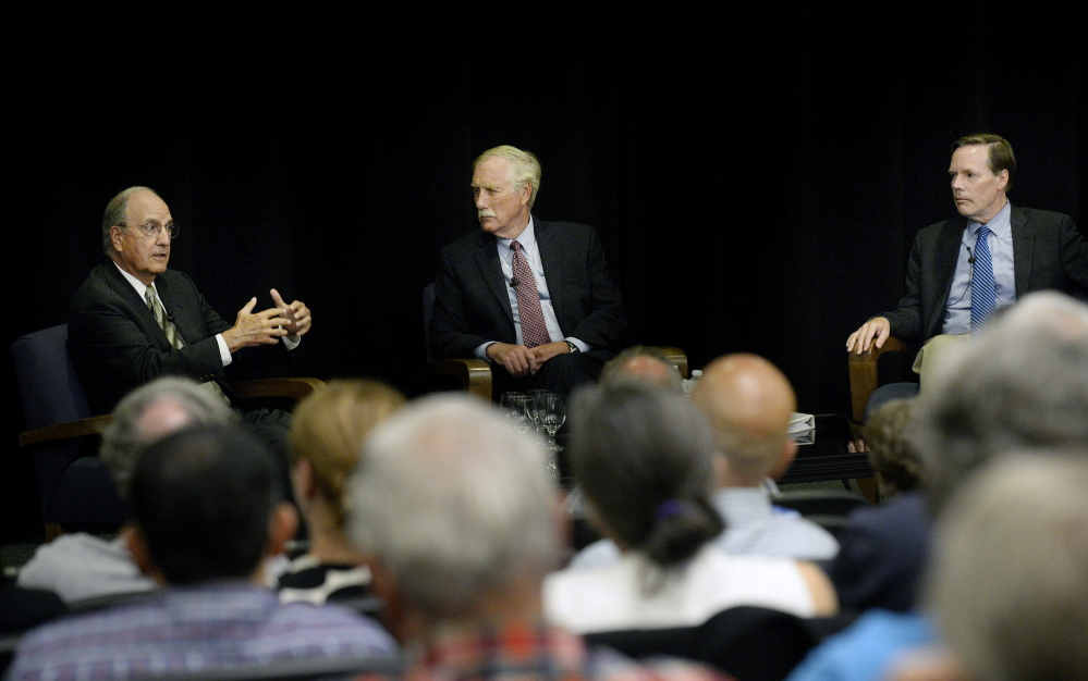 Left to right, former U.S. Sen. George Mitchell, U.S. Sen. Angus King and former Ambassador Nicholas Burns discuss the Iran nuclear deal at the University of Southern Maine on Wednesday.