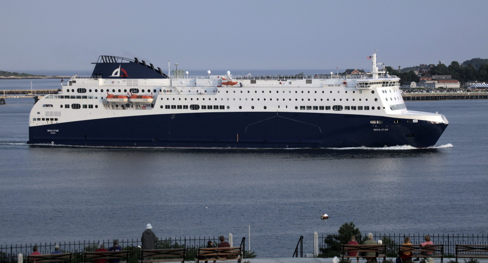 The Nova Star ferry, shown entering Portland Harbor, offers amenities only found on a large ship. Officials in Nova Scotia have the option, however, to go with a cheaper ferry service that is more of a bare-bones transport.