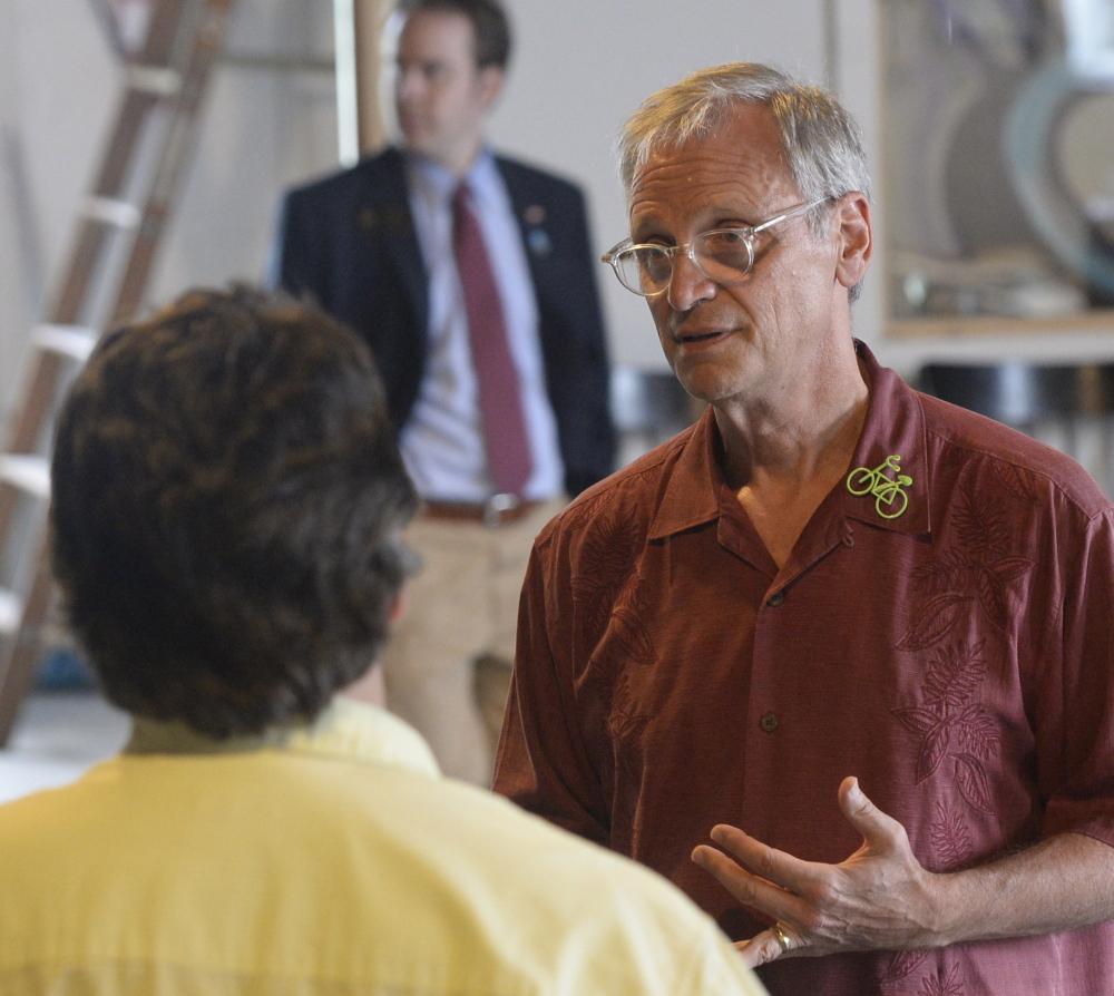 U.S. Rep. Earl Blumenauer, D-Ore., meets with individuals after speaking about marijuana at the Urban Farm Fermentory in Portland on Thursday.