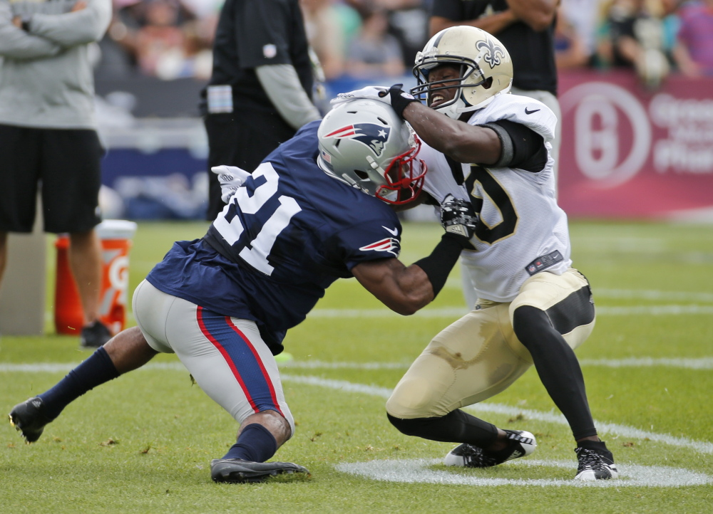 Patriots corner Malcolm Butler, left, tangles with Saints receiver Brandin Cooks during a joint practice Thursday, when Butler bounced back after struggling Wednesday.