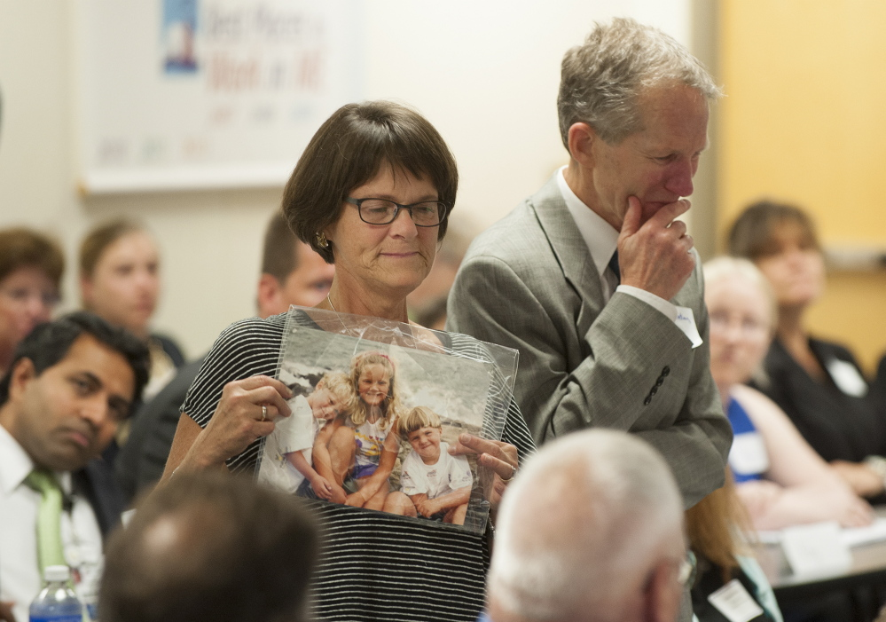 Dr. Lynn Keating of Brunswick, along with her husband, Dr. Thomas Keating, relates how their son died as a result of his opiate addiction, during a roundtable discussion Tuesday in Brewer.