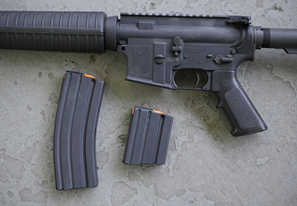 Wal-Mart's spokesman says the decision to stop selling the AR-15 rifle is not political.