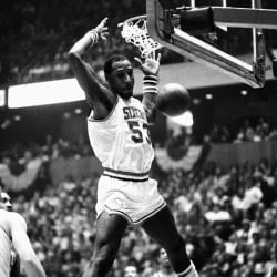 Darryl Dawkins dunks against the Atlanta Hawks while playing for the Philadelphia 76ers in an NBA playoff game in 1980. Dawkins, whose backboard-shattering dunks helped pave the way for breakaway rims, died Thursday at the age of 58.