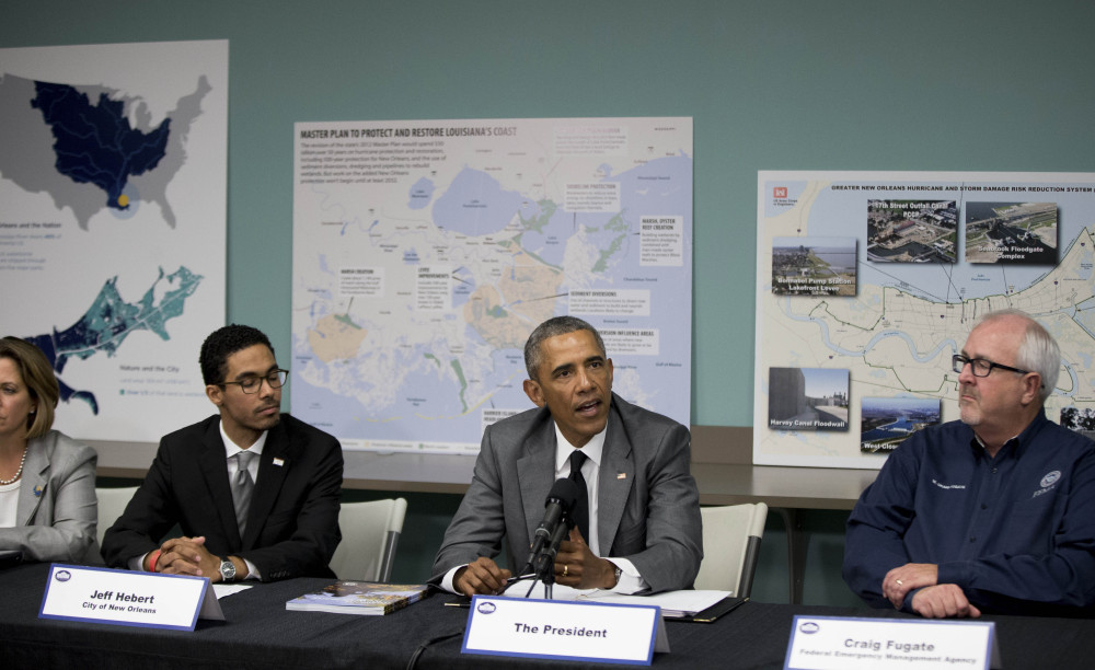 President Obama participates in a roundtable on Hurricane Katrina at the Andrew P. Sanchez Community Center in New Orleans, Thursday, Aug. 27, 2015, while visiting for the 10th anniversary since the devastation of Hurricane Katrina. The roundtable highlighted  advancements in national preparedness, showcase Gulf Coast resiliency, mark the achievements of the New Orleans community over the past 10 years with opportunities to build future resilience.(AP Photo/Andrew Harnik)