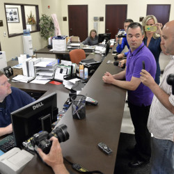 William Smith Jr., right, and his partner James Yates, center, speak with an unnamed clerk in an attempt to obtain a marriage license Thursday in Rowan County, Ky.