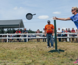 ACTON,  ME - AUGUST 29: Amy Chartrain of Salem, NH tosses her skillet during the skillet throwing contest at the Acton Fair in Acton, ME on Saturday, August 28, 2015.  (Photo by Whitney Hayward/Staff Photographer)