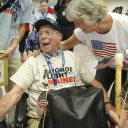 Veteran Henry Poisson of Turner is all smiles after getting a hug from his daughter, Cheryl Washburn, upon his return to Portland after an Honor Flight trip to Washington, D.C. on Saturday and Sunday. Poisson and 26 other veterans went on the free trip organized by Honor Flight Maine to visit memorials and Arlington National Cemetery. Poisson, 92, is a veteran of World War II and Korea and was awarded two Silver Star Medals and a Bronze Star Medal.