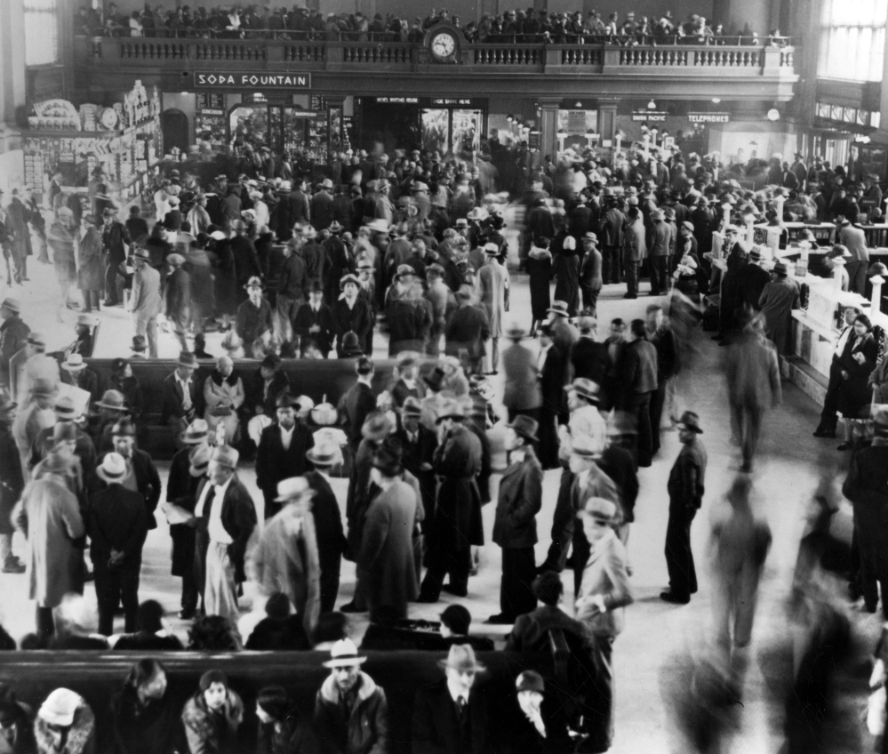 This 1932 photo from a collection at the Los Angeles Public Library shows hundreds of Mexican immigrants at a Los Angeles train station awaiting deportation because they were thought to be competing for jobs with whites.