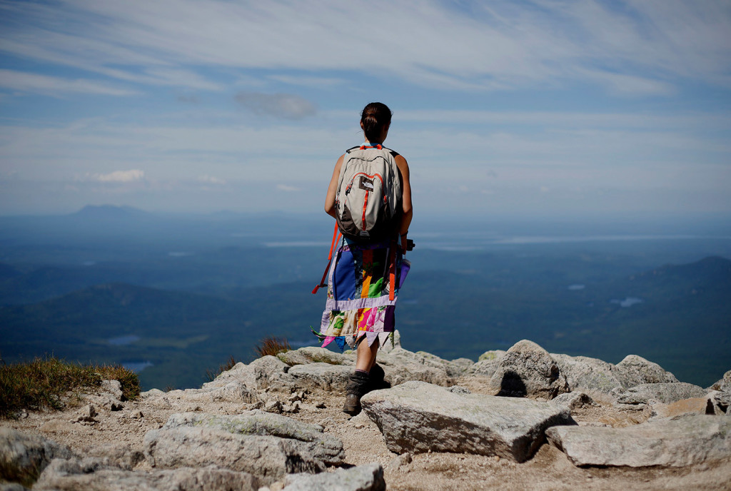 """Sarah Morse of North Berwick, who hiked the Appalachian Trail last year using the trail name """"Leap Frog,"""" takes in the view near the summit of Mount Katahdin. This year, Baxter State Park is issuing permits to hikers who want to end the trek on Katahdin."""