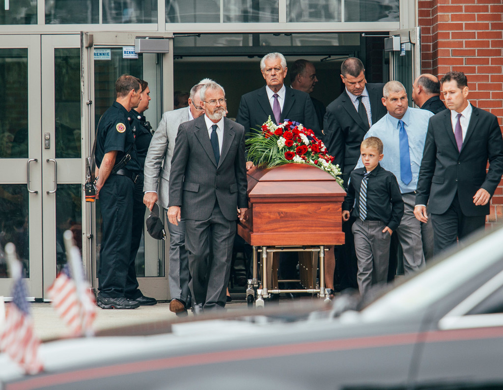Family and friends escort her casket after services for Wendy Boudreau at Thornton Academy in Saco on Tuesday.