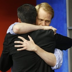 WDBJ-TV7 anchor Chris Hurst, right, hugs meteorologist Leo Hirsbrunner during the early morning newscast at WDBJ-TV7, in Roanoke, Va., Thursday. Hurst was the fiance of Alison Parker, who was killed during a live broadcast Wednesday, in Moneta. The Associated Press