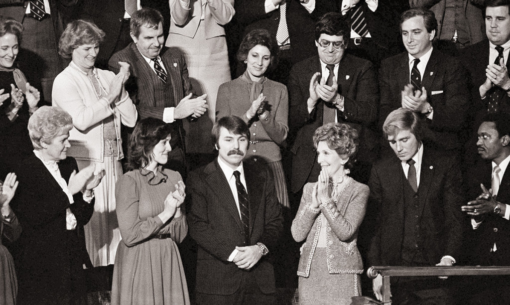 In this Jan. 27, 1982, photo, Lennie Skutnik, center front,  the man who jumped into the Potomac River and saved one of the passengers aboard the Air Florida jetliner that crashed on Jan. 13, receives applause from first lady Nancy Reagan and other dignitaries in Capitol Hall in Washington. The applause came when President Ronald Reagan made mention of the event while making his State of the Union address to a joint session of Congress. The Associated Press