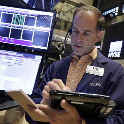 Trader Mark Puetzer works on the floor of the New York Stock Exchange, Friday, Aug. 28, 2015. U.S. stocks are opening slightly lower after a sharp two-day surge, as the stock market closes out a wild week. (AP Photo/Richard Drew)