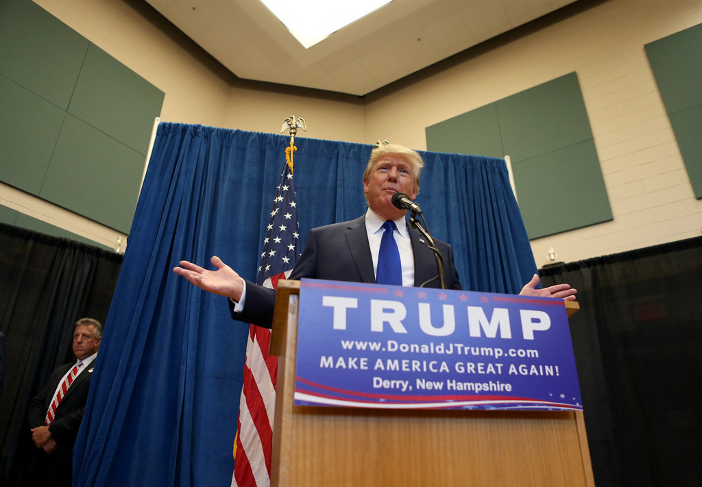 Republican presidential candidate and businessman Donald Trump speaks to the media at Pinkerton Academy in Derry, N.H.