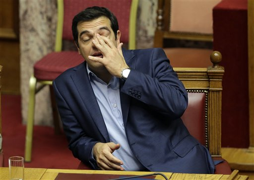 Greece's Prime Minister Alexis Tsipras reacts  during an emergency parliament session in Athens on July 23. The Associated Press