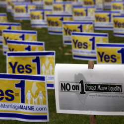 "Posters urging Mainers to vote to repeal Maine's same-sex marriage law are seen in Portland in 2009, along with a ""No on 1"" campaign poster. The National Organization for Marriage, which gave $2 million to the campaign against gay marriage in Maine, revealed its donors for the first time Monday."