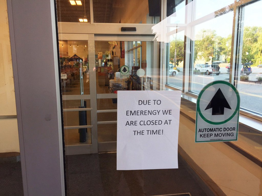A sign announces that a Shaw's supermarket in Saco is closed to customers after a woman was stabbed to death there Wednesday.