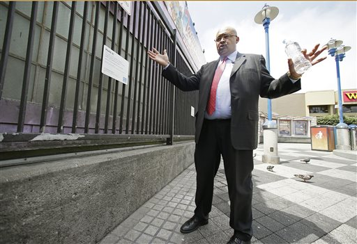 Mohammed Nuru, director of San Francisco Public Works, talks about the city's latest effort to clean up urine-soaked walls outside a Mission District transit station. The Associated Press
