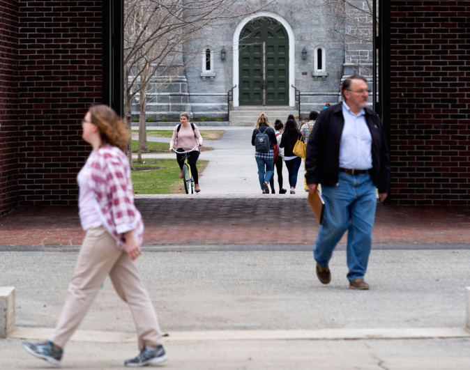 Pedestrians and bicyclists make their way through the Bowdoin College campus in Brunswick. The school is ranked fourth in the nation in U.S. News & World Report's latest rankings. 2015 Press Herald file photo/Gabe Souza