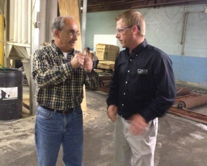 U.S. Rep. Bruce Poliquin, a Republican from Maine's 2nd District, left, speaks with Brody Cousineau, vice president of Cousineau Wood Products, during a Tuesday tour of the company's North Anson facility. (Staff photo by Michael Shepherd)