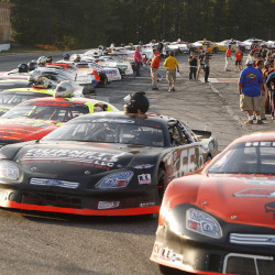 Qualifying racers are lined up before the start of the Oxford 250 Sunday. Carl D. Walsh/Staff Photographer