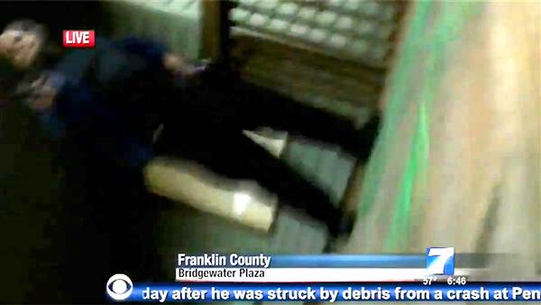 In a screengrab taken from a WDBJ7 broadcast, a person dressed in black is seen near where two people were killed and another seriously wounded. Photo by WDBJ-TV