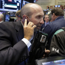 Trader James Denaro works on the floor of the New York Stock Exchange, Tuesday, Sept. 1, 2015. More signs of weakness in China's economy are sending global stock markets sharply lower. (AP Photo/Richard Drew)