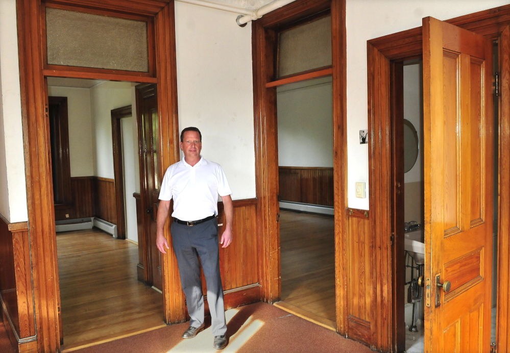 Bill Mitchell stands on the second floor of the Masonic building on Common Street in Waterville that he recently bought and plans to renovate and lease.