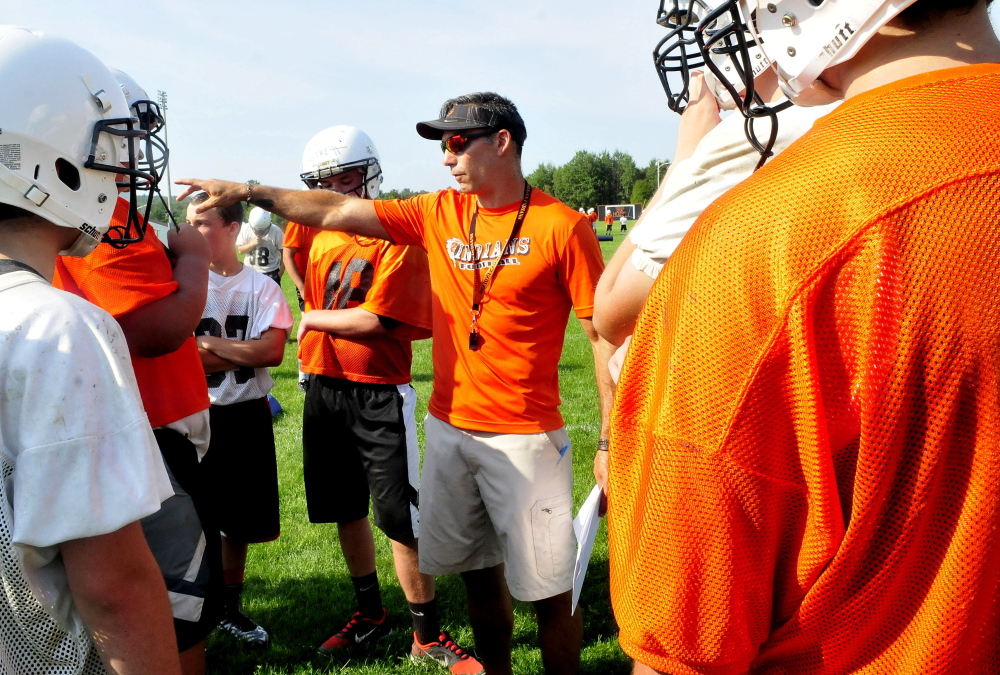 Skowhegan Area High School head football coach Matt Friedman instructs players during practice on Aug. 17. Skowhegan has plenty of big games on the schedule ths year, includng Friday night when it plays Lawrence.