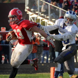 Photo by Jeff Pouland   Cony High School running back Reid Shostak fights off Lawrence's Dustin Simpson-Bragg to score a second half touchdown during a Pine Tree Conference Class B seminfinal game last season.