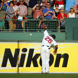 Boston Red Sox right fielder Jackie Bradley Jr. goes up against the wall but can't get to a home run hit by New York Yankees' Didi Gregorius during the fifth inning Wednesday at Fenway Park in Boston. New York won 13-8.