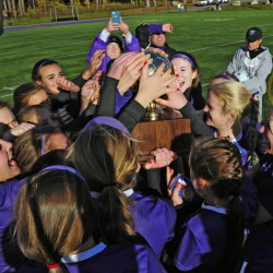 Staff file photo by Joe Phelan   The Waterville girls soccer team celebrates after it edged Cape Elizabeth 1-0 to win the Class B state championship last season. The Purple Panthers have a new coach but same expectations this season.