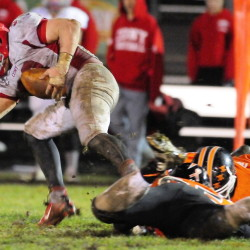 Stafff file photo by Joe Phelan FIGHTING FOR YARDS: Cony running back Reid Shostak, left, gets tripped up by Gardiner defenders during the annual rivalry game last fall. Shostak leads a Cony team that hopes to contend in tough Pine Tree Conference Class B.