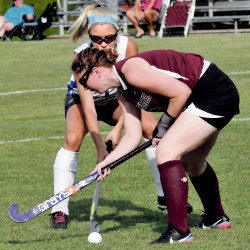 Staff photo by David Leaming   Nokomis' Jessica Cloutier, front, and Lawrence's Hallee Parlin go after a loose ball during a Kennebec Valley Athletic Conference Class B game Thursday in Fairfield. The Bulldogs won 4-1.