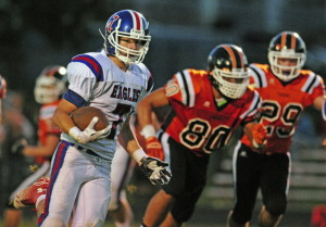 Staff photo by Joe Phelan   Messalonskee halfback Colby Dexter runs the ball during a Pine Tree Conference Class B game Friday night at Hoch Field.